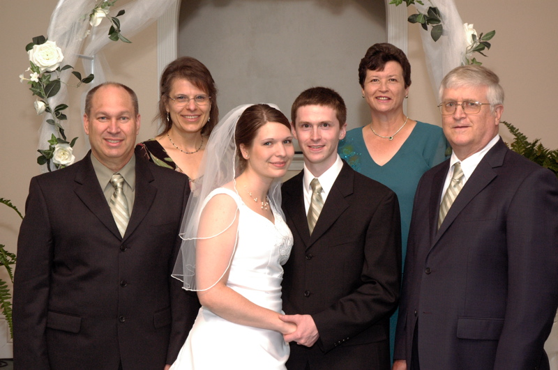 <p>Aaron and Kari at their wedding with their parents</p>