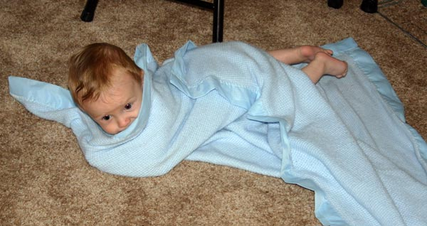 <p>Christian rolled up in a blanket</p>