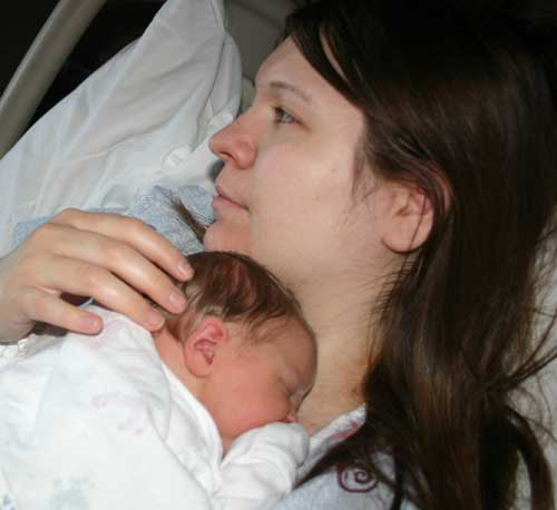 Kari holding her new son, Christian