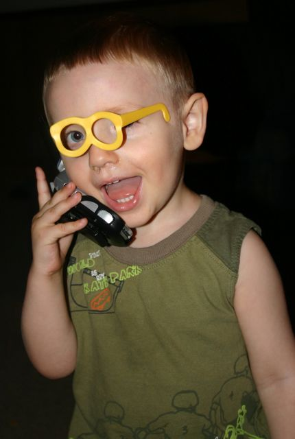 Christian with Mr. Potato Head glasses–talking on the phone